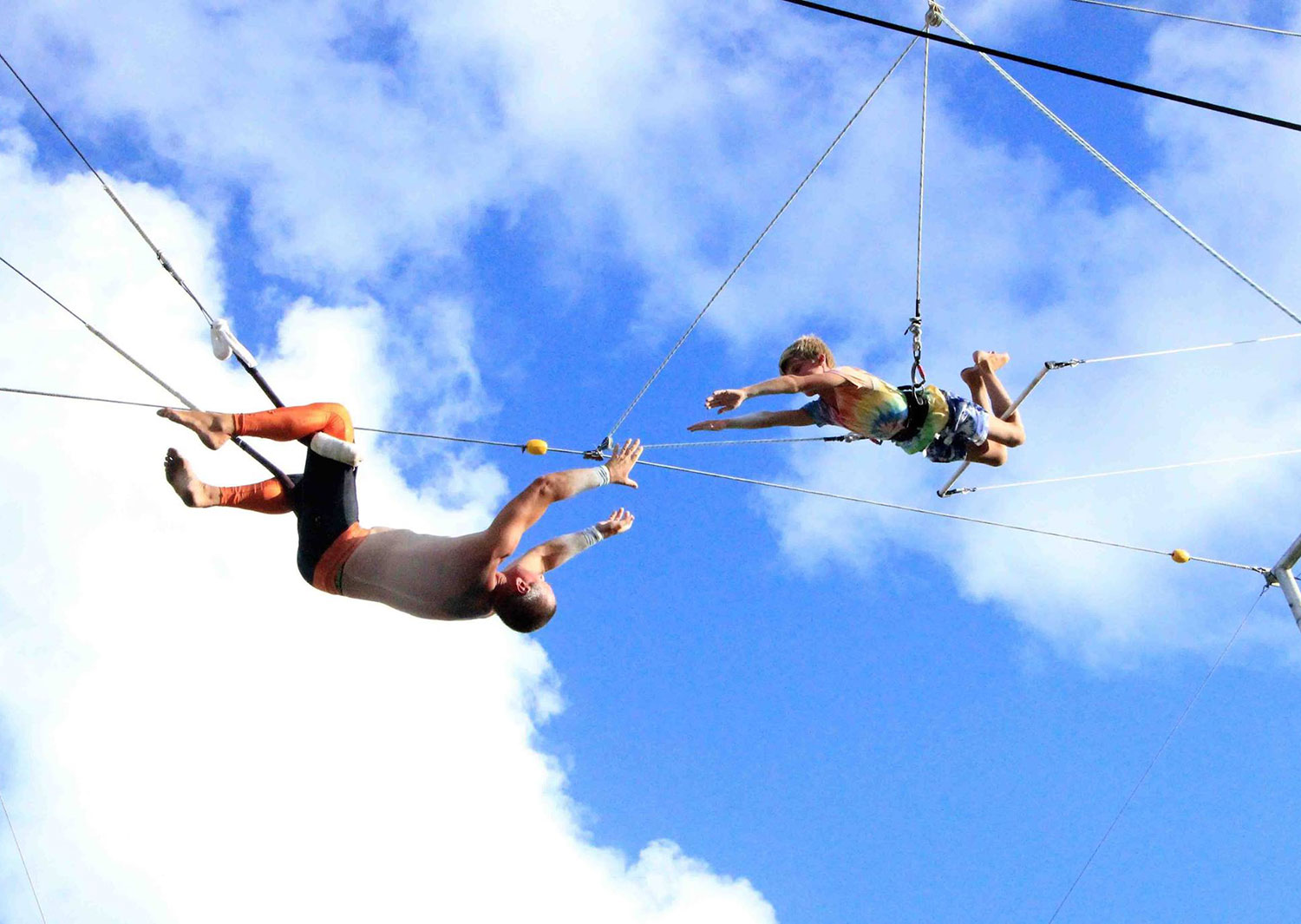 Catch mid-air in kids mixed flying trapeze and circus class in Sydney